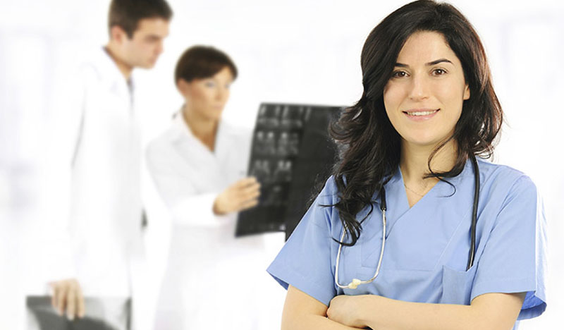 Wellspect Science Young healthcare professional smiling into camera