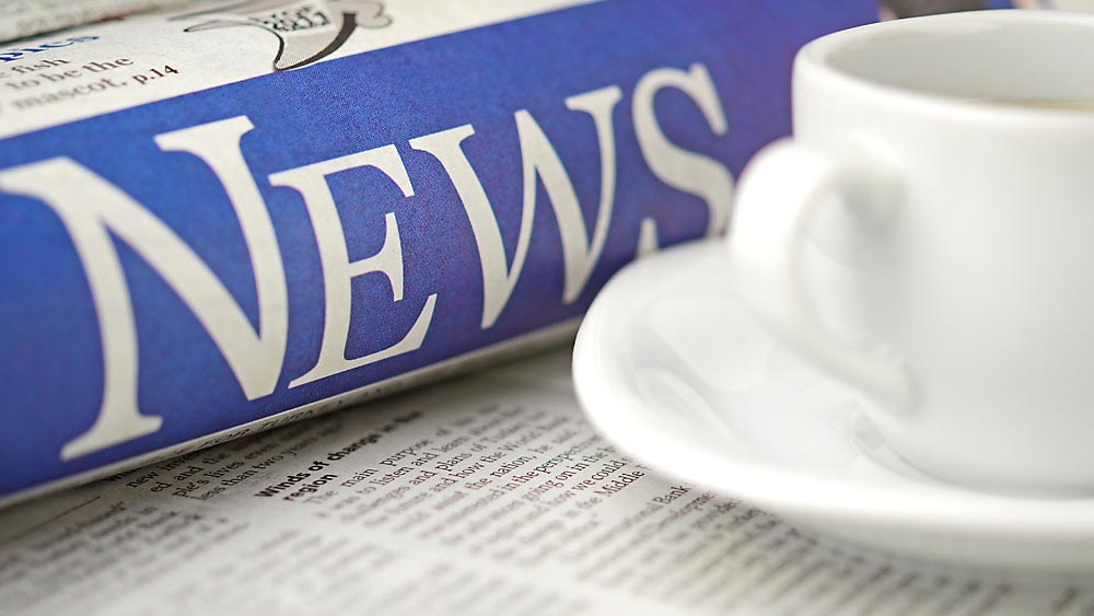 Wellspect Coffee mug and rolled-up newspaper